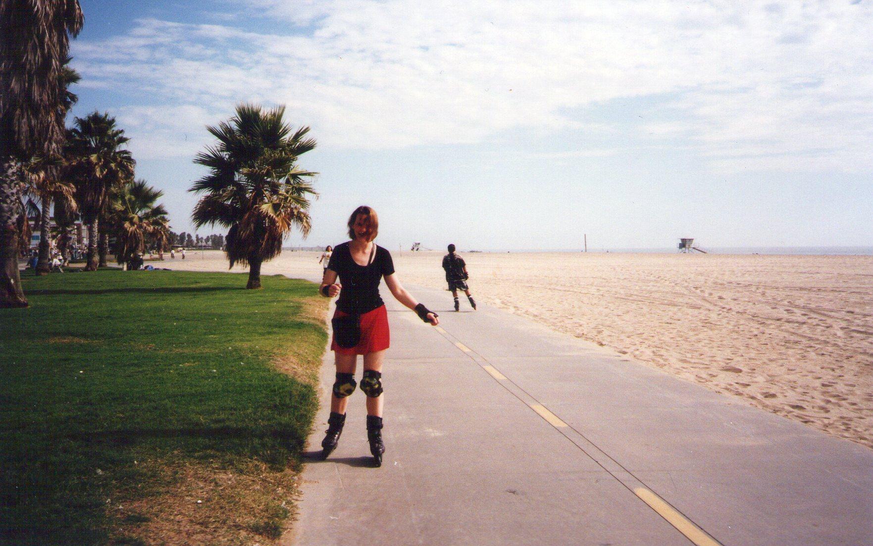 writer Ali Mercer rollerblading on Venice Beach California in the 90s